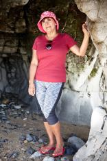 Mature hispanic woman in beach sea cave