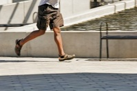 Man running on the footpath.