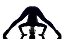 woman exercising Prasarita Padottanasana Wide Legged Forward Ben