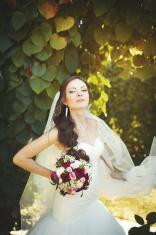 Beautiful bride in sunglasses walking  garden.