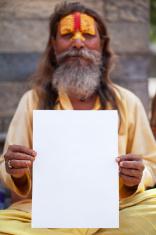 Portrait of Holy Sadhu man holding blank paper