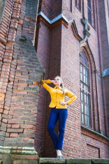 Girl posing in an old cathedral