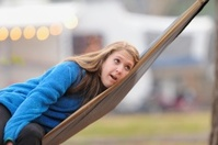 Girl resting in hammock in rv campground