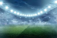 Dramatic football stadium with fog