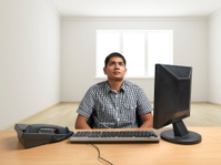 Man seated in isolated room feeling depressed
