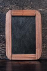 Vintage chalk board on a wooden textured background