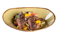 Roast beef with vegetables. warm salad