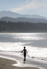 Young Child Enjoying The Beach
