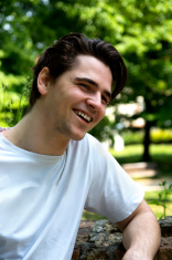 Attractive young man smiling in nature environment