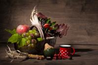 Picturesque autumn composition with  basket, fruits, pumpkin, mu