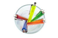 Multi-colored pens in a glass