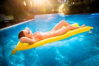 Girl on Lilo in Swimming Pool