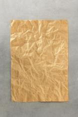 wrinkled paper at metal background