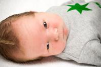 newborn baby boy with his eyes open