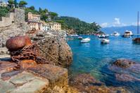 Old bollard on ruins of ancient port in Portofino.