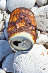Rusty tin on gravel