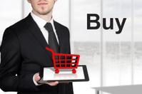 businessman holding tablet red cart buy
