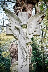 Angel on cross statue
