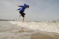 boy jumps in sea