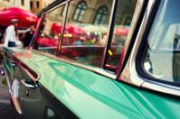Evening city lights in glasses vintage car