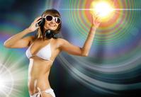 Bikini girl wearing headphones