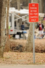 No parking beyond this point campers only sign