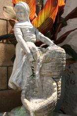 Young girl water fountain