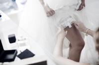 Bride putting on wedding bridal garter belt underwear lingerie