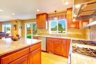Bright luxury kitchen room with exit to backyard
