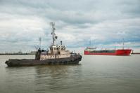 Tugboat and tanker.