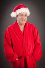 Middle age happy men wearing santa hat