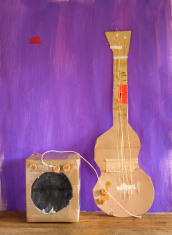 grungy cardboard guitar w. amplifer, free copy space