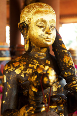 Wooden buddha statue with leaf gold
