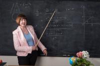 Happy  older female teacher with pointer stick
