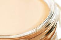 Pink tonal cream fragment close-up