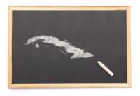 Blackboard with the shape of Cuba drawn onto.