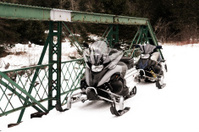 Snowmobiles on Bridge