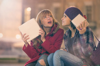 Young couple friends exchange christmas gifts outdoor