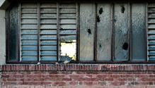 Broken Window on Old Abandoned Industrial Building