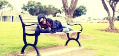 Homeless woman waking up