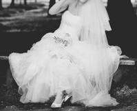 Bride plays around with her dress