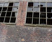 vandalism broken destroyed windows  in industrial building
