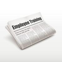 employee training words on newspaper