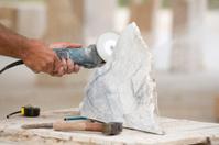 Sculptor Working