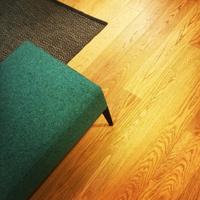 Green stool on wooden floor