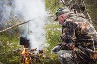 Huntsman has been cooking over a campfire