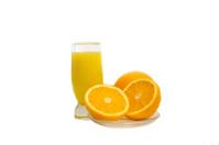 Glass of orange juice and oranges together.