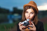 Beautiful hipster girl shooting