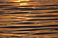 water texture steel sunset orange