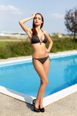 Sexy woman posing at swimming pool